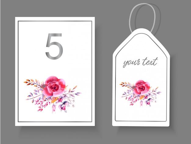 Label, tischnummer mit zarten rosa rosenblüten und dekorativen zweigen für die hochzeitsdekoration