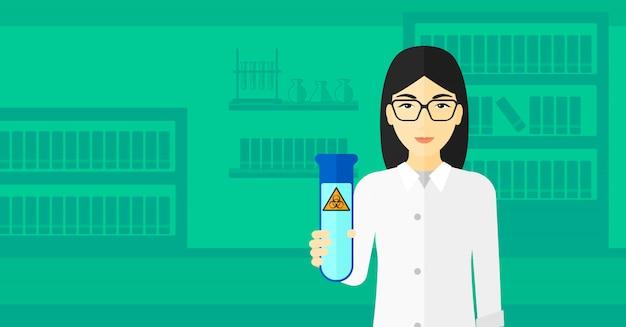 Laborantin mit reagenzglas.