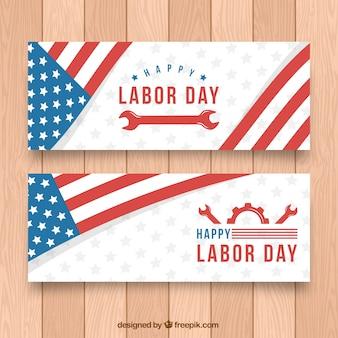 Labour day banner mit amerikanischer flagge und schraubenschlüssel