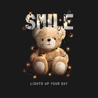 Lächeln slogan mit bärenpuppe und leuchtender lichterkette vektorgrafik auf schwarzem hintergrund