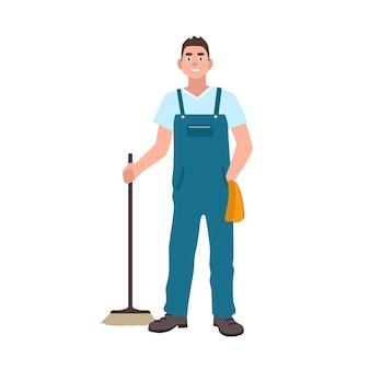 Lächelnder mann in latzhose mit wäscher auf weißem hintergrund gekleidet. männliche reinigungskraft mit bodenbürste. hausmeister, reinigungskraft oder kehrmaschine. flache cartoon bunte vektor-illustration.