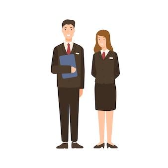 Lächelndes karikaturmann- und -frauenhotelpersonal lokalisiert auf weiß. glücklicher freundlicher leutecharakter in der flachen illustration des einheitlichen vektors. positiver männlicher und weiblicher mitarbeiter des betriebspersonals.