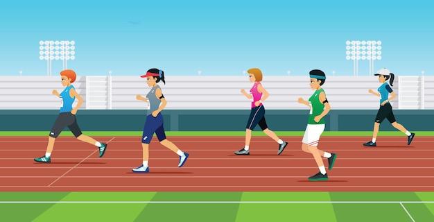 Läuferinnen treten auf dem feld an.