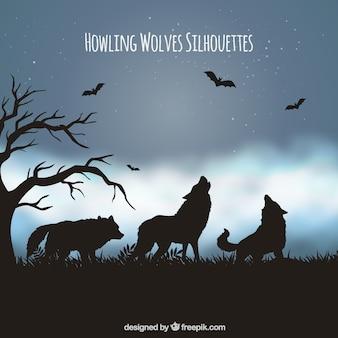 Landschaft hintergrund mit silhouette der wölfe und fledermäuse
