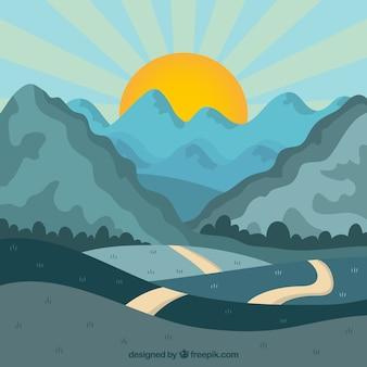 Landschaft mit bergen und straße bei sonnenuntergang
