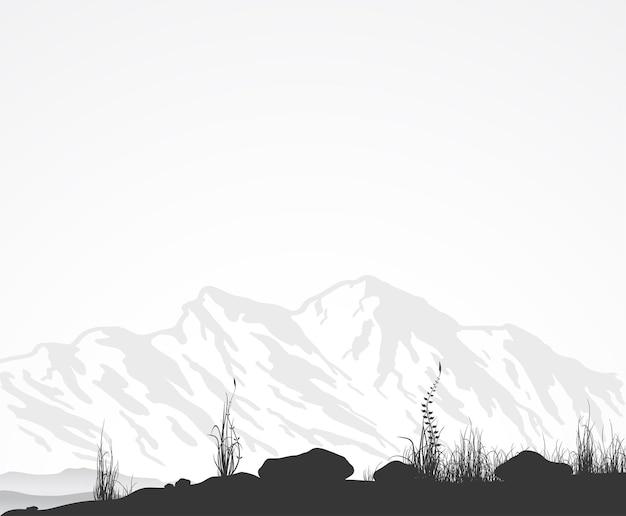Landschaft mit gebirgszug, gras und steinen.