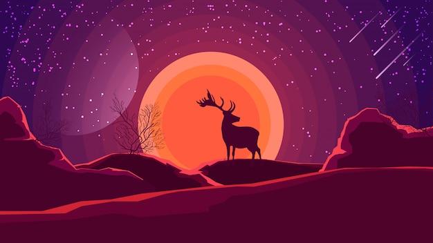 Landschaft mit sonnenuntergang über den bergen und silhouette eines hirsches