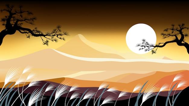 Landschaftsherbst-rasenfläche mit berg bei sonnenuntergang