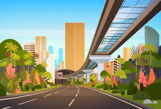 Landstraßen-straße zu den stadt-skylinen mit modernen wolkenkratzern und bahnstadtbild-ansicht
