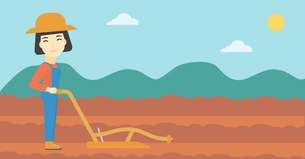 Landwirt auf dem feld mit pflug