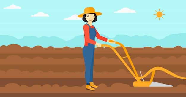 Landwirt auf dem feld mit pflug.