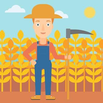 Landwirt auf dem feld mit sense
