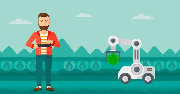 Landwirt, der arbeit des roboters am feld überprüft.