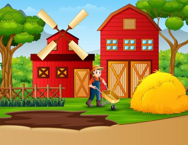 Landwirt, der in einem bauernhofhintergrund arbeitet