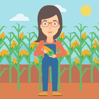 Landwirt hält mais