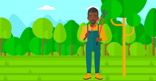 Landwirt mit gartenschere im garten.