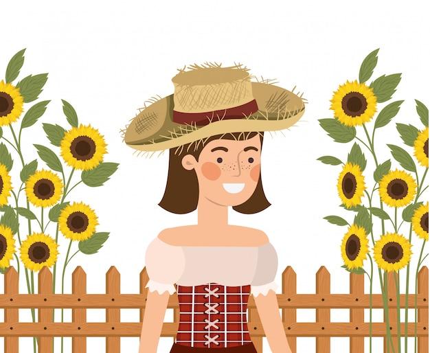 Landwirtfrau mit strohhut und sonnenblumen