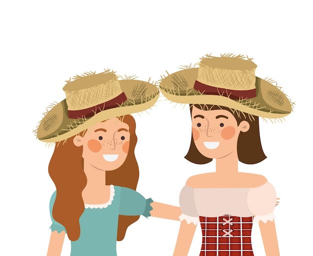 Landwirtfrauen, die mit strohhut sprechen