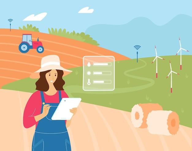 Landwirtin, die mit einer tablette arbeitet