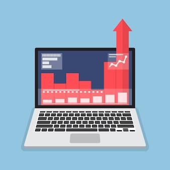 Laptop mit geschäftsdiagrammwachstum heraus vom monitor