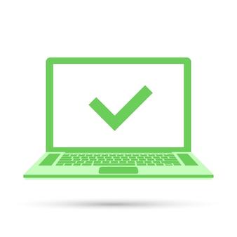 Laptop mit häkchen auf grünem bildschirm