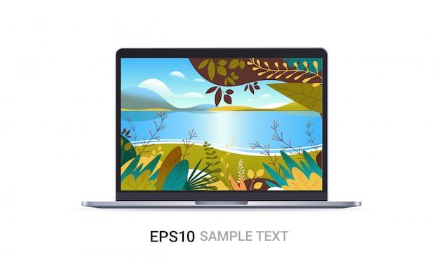 Laptop mit schöner seelandschaft auf dem bildschirm lokalisiert auf weißen wand realistischen modellgeräten
