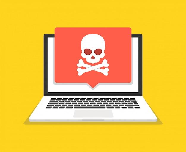Laptop mit totenkopf auf dem bildschirm. konzept des virus