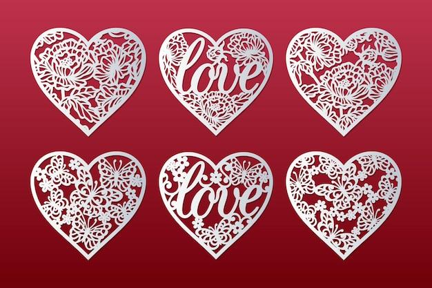 Lasergeschnittene herzen eingestellt mit muster von pfingstrosen, schmetterlingen, blumen und wortliebe, valentinskartenentwurf.