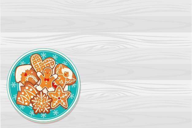 Lebkuchen-weihnachtsplätzchen auf blauem teller mit schneeflocken auf holztisch. draufsichtvektorillustration für neues jahr- und winterferiendesign.