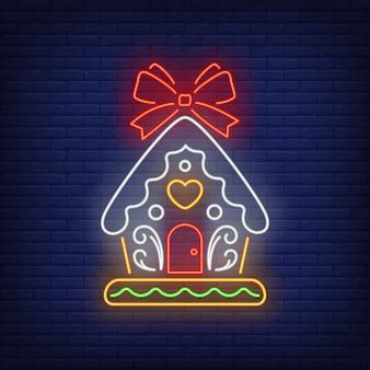 Lebkuchenhaus mit roter schleife in der neonart