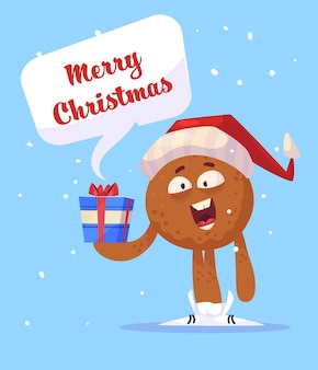Lebkuchenmann, der ein geschenk hält und frohe weihnachten wünscht.