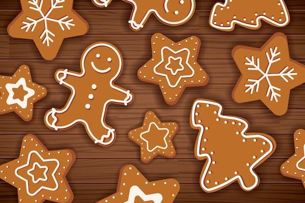 Lebkuchenmann der frohen weihnachten auf holztisch