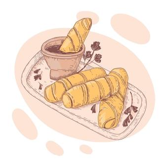 Leckere tequeños-sticks mit sauce abgebildet