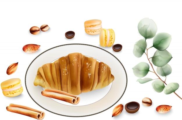 Leckeres croissant mit zimtstangen, macaron-süßigkeiten und toffee-bonbons auf dem tisch