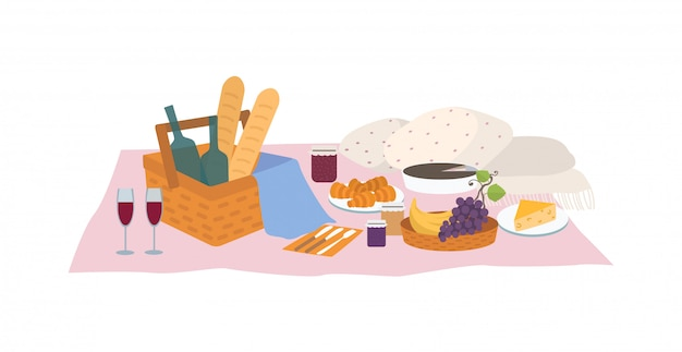 Leckeres essen und getränke, die im korb und auf der decke lokalisiert auf weißem hintergrund liegen. leckere mahlzeiten und wein zum abendessen oder picknick im freien.
