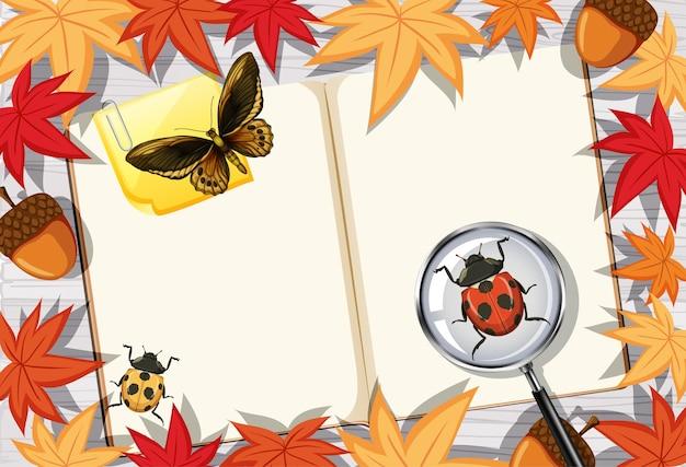Leere buchseite auf büroarbeitstisch-draufsicht mit blättern und insektenelementen
