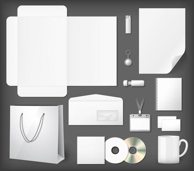 Leere corporate identity mock-ups gesetzt. notizblock, cd-cover, einkaufstasche, usb-stick, feuerzeug, umschlag, kaffeetasse.