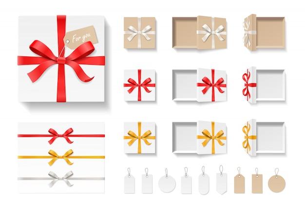 Leere offene bastelgeschenkbox, rote farbe bogenknoten, band und tag-set lokalisiert auf weißem hintergrund. alles gute zum geburtstag, weihnachten, hochzeit, valentinstag-paketkonzept.