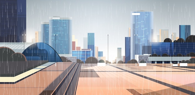 Leere regentropfen in der innenstadt fallen auf die stadtstraße ohne menschen und autos regnerischer sommertag