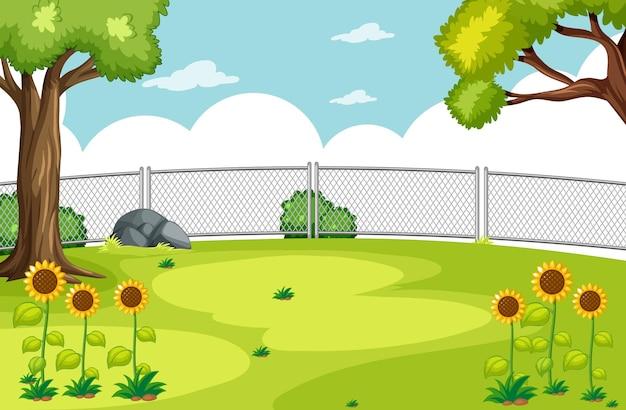Leere szene im park mit sonnenblumen und strahlend blauem himmel
