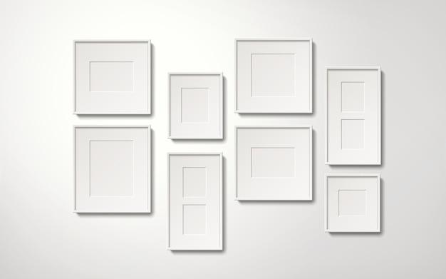 Leere weiße bilderrahmensammlung, die an der wand hängt, realistischer stil der 3d-illustration
