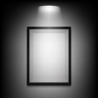 Leerer beleuchteter bilderrahmen auf schwarzem hintergrund.