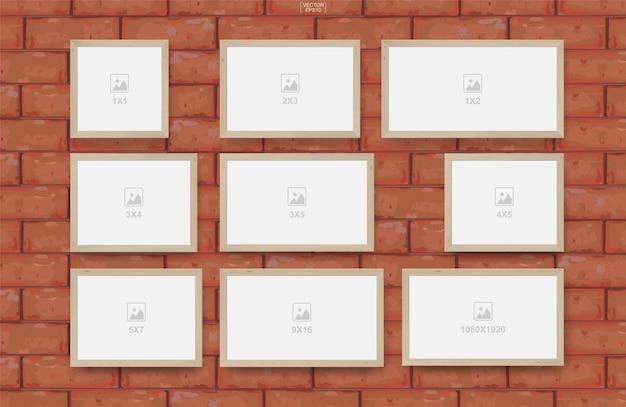 Leerer fotorahmen auf rotem backsteinmauertexturhintergrund