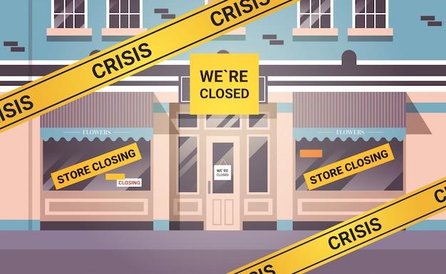 Leerer geschlossener blumenladen mit gelbem konkursschließband coronavirus-pandemiequarantäne
