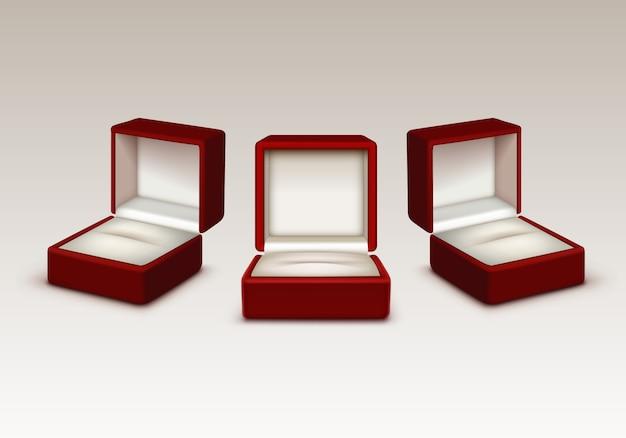 Leerer roter und weißer samt geöffnete geschenkschmuckschachteln