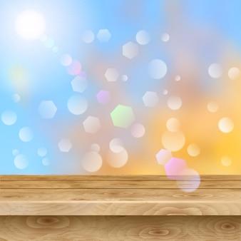 Leerer tisch aus hellbraunen holzbohlen auf herbsthintergrund mit sonne und blendlicht