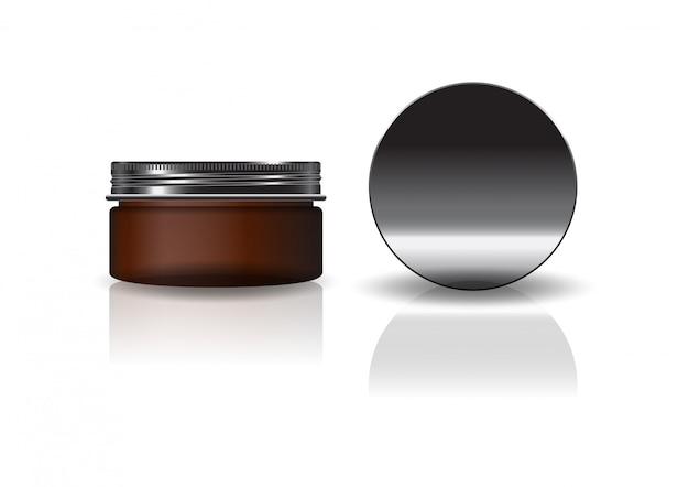 Leeres braunes kosmetisches rundes glas mit schwarzem deckel.