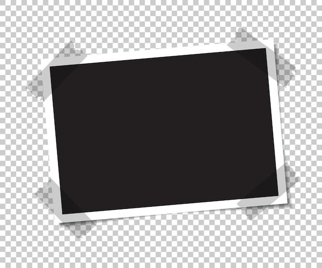 Leeres foto mit einem schatten wird mit klebeband verklebt.