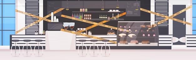 Leeres geschlossenes cafe mit gelbem klebeband