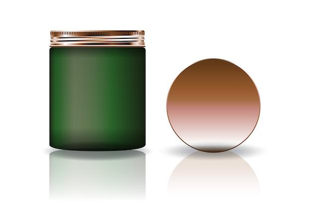 Leeres grünes kosmetisches rundes glas mit kupfernem deckel im hohen maß.
